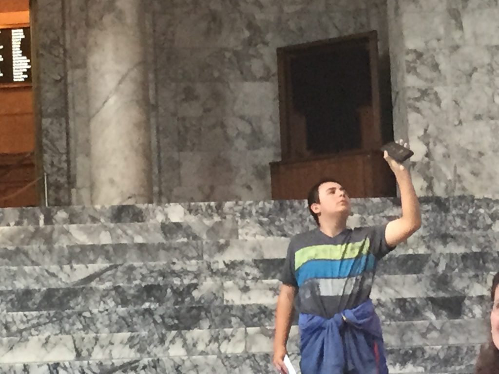 Aiden taking photos of the amazing interior of the Washington State Capitol in Olympia